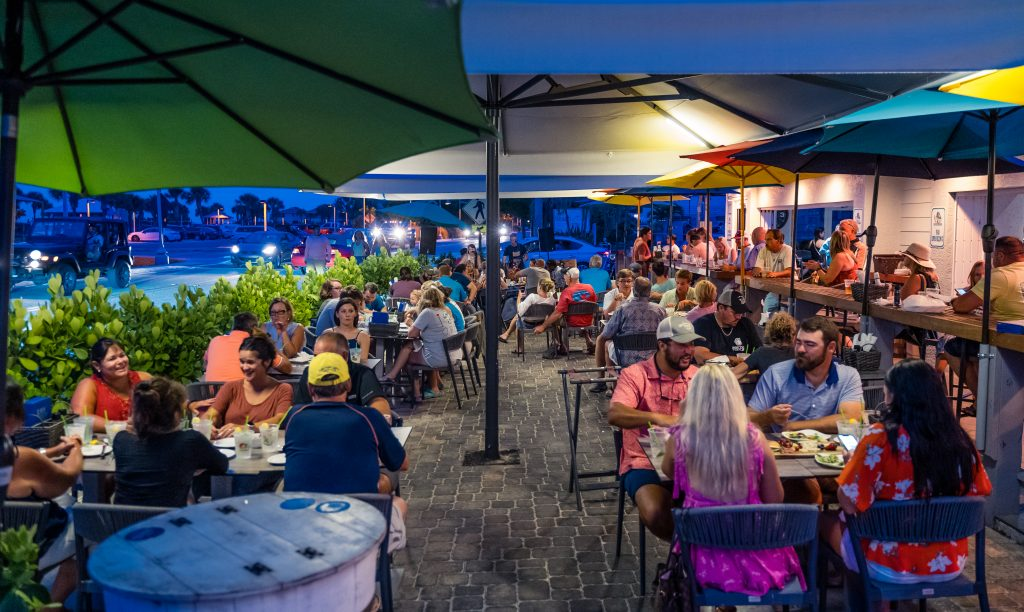 patrons eating, drinking and having fun in Lock N Key's outdoor seating area